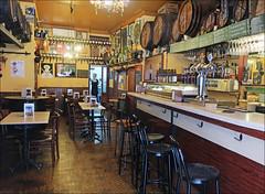 Just before Opening - Barcelona, Spain (TravelsWithDan) Tags: woman bartender server bar restaurant beforeopening throughtheglass candid street barcelona spain europe city urban life canong9x