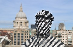 The London Street Artist.... (markwilkins64) Tags: millenniumbridge portraiture portrait london southbank southwark uk streetphotography street candid lines stripes fancydress sculpture humanstatue humansculpture humanart art stpaulscathedral thecity streetartist man markwilkins facepaint hat bokeh