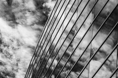 the end of the beginning (fallsroad) Tags: sigma135art tulsaoklahoma city urban arena bokcenter windows glass reflections sky blackandwhite bw monochrome