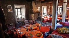 Morocco - Atlas Mountains - Mar 2018 - Hotel Dining Room (Gareth1953 All Right Now) Tags: morocco atlasmountains hotel diningroomcandles windows pillows grate fireplace carpets traditional orange red