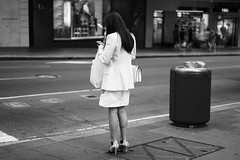 Pick Up (McLovin 2.0) Tags: bw street streetphotography urban city sydney people candid bokeh sony a7s 55mm zeiss legs fashion style