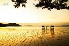 The Land of the Rising Sun (Naoshima Island, Japan 2015) (Alex Stoen) Tags: 500px alexstoen alexstoenphotography architecture art benessehouse canoneos1dx chairs couple deck ef2470mmf28liiusm flickr geotagged golden google horizon japan kagawa museum ngexpeditions naoshimaisland natgeo nationalgeographicexpeditions pair profile puntodefuga set silhouette sunrise terrace travel vacation vanishingpoint creativecomposition facebook infinity lines