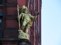 Puck Building Cherub - What Fools These Mortals Be 1776 (Brechtbug) Tags: gold statue baby puck character with top hat holding mirror from old humor cartoon magazine the building lafayette street new york city 02162019 nyc 2019 east houston st downtown manhattan william shakespeare putti cherub cherubim art architecture buildings cupid like valentines day holiday