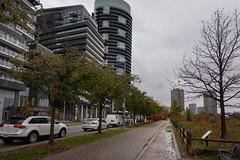 Pity it was Rainning (Jocey K) Tags: sonydscrx100m6 triptocanada ontario canada autumn autumncolour toronto trees clouds sky architecture car street sign buildings puddles