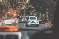 Chasing (FOXTROT|ROMEO) Tags: beetle car auto german käfer vw volkswagen taxi police chasing chase bali indonesia travel