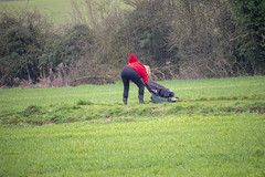 DSC_5064 (photographer695) Tags: scawby north lincolnshire lady red sweater cutting grass public right way used by dog walkers