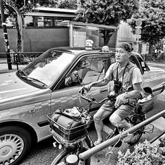 shibuya, japan (michaelalvis) Tags: bicycles asia bw blackandwhite bicycle candid city citylife cigarette fujifilm flickr japan japanese japon monochrome mono nihon nippon peoplestreet portrait people peoplestreets streetphotography streetlife street travel tokyo urban x70 taxi cab