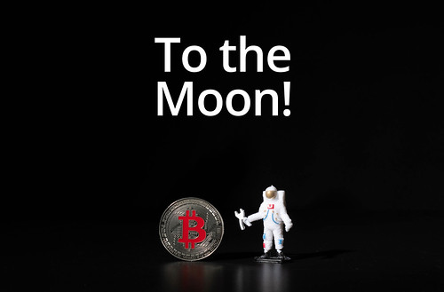 Astronaut with Silver Bitcoin and To the Moon text
