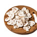 Sliced Mushrooms on the wooden board