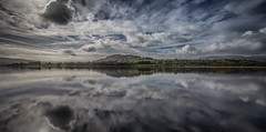 Clouds (paullangton) Tags: clouds lake water sky blue wales reflection sun green llangorse valley trees field brecon