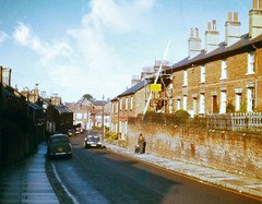 Another view of Flaxfield Road (Beardy Vulcan II) Tags: basingstoke flaxfieldroad road street terrace house urban hampshire england autumn fall october 1975 20thcentury building sky