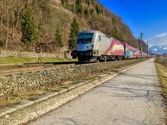 ÖBB railjet express train with Austrian flag livery and overtones of graffiti near Kufstein, Tyrol, Austria (UweBKK (α 77 on )) Tags: öbb österreich railjet express train railway rail austrian flag graffiti river inn kufstein tirol tyrol austria europe europa iphone