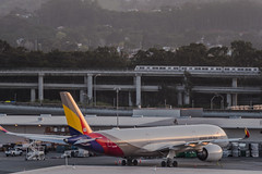 asiana airlines flight oz 211 holding for gate assignment (pbo31) Tags: bayarea california nikon d810 color april 2019 boury pbo31 spring sanfranciscointernational sfo aviation airport sanbruno sanmateocounty flight plane travel airline over airbus asiana holding parked a350 bart