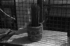 (grousespouse) Tags: vietnam 35mm analog film pentaxk1000 rikenon50mmf17 promax100 blackandwhite monochrome damagedfilm incense pot temple pagoda chinatown cholon saigon hcmc hochiminhcity analogue asia oriental shadow argentique scanned phim croplab 2018 grousespouse