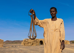 Bedouin arab man with a leather tool for kitchen, Northern State, Bayuda desert, Sudan (Eric Lafforgue) Tags: adultsonly africa arab bayoda bedouin bisharin colorimage copyspace cultures day horizontal leather lookingatcamera men nomad northernstate onemanonly oneperson photography portrait sudan sudan180801 traditionalclothing traveldestinations bayudadesert sd
