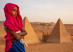 Portrait of sudanese girl visiting the pyramids of the kushite rulers at Meroe, Northern State, Meroe, Sudan (Eric Lafforgue) Tags: africa ancient ancientcivilization archaeology architecture blackpharaohs cemetery child children colorimage copyspace day desert famousplace girls horizontal mausoleum meroe meroitic northsudan northerncemetery nubia onegirlonly oneperson outdoors photography placeofburial pyramid reconstructed red saharadesert sudan sudan180939 thepast tomb tourism tourists traditionalclothing tranquilscene travel traveldestinations unescoworldheritagesite veil waistup northernstate sd