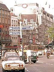 Street scene   Amsterdam  August 1975 (D70) Tags: street scene amsterdam august 1975 jordaan northholland cars tram motorcycle bicycle bike people opel gt volvo station wagon 140 series 140series wimpy klm signs