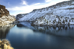 Lake Billy Chinook, Oregon in winter (Bonnie Moreland (free images)) Tags: oregon winter snow mountains cliffs water lake blue shadows sunlight reflections lakebillychinook trees rocks