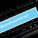 #savetheinternet text on a black computer keyboard