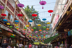 Yangshuo (Warp Factor) Tags: 2018 canont4i china tamron2470f28 tour vacation sightseeing guilin historic history fall2018 yangshuo umbrellas street shops stores