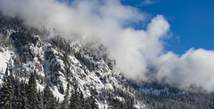 Clearing Skies over Winter Peaks (s.d.sea) Tags: snow alpental mountains mountain winter cascades snoqualmie summit washington washingtonstate wa pnw pacificnorthwest pentax k5iis 55300mm telephoto clouds weather moody mood white blue terrain cliffs december outdoors outside trees