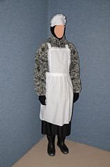 Warm Clothed Slave Maid (Warm Clothes Fetish) Tags: maid apron sweat torture boots girl fleece fur hat coat