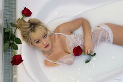 Ania in milk bath (piotr_szymanek) Tags: ania aniaz woman young skinny portrait studio bath bathtube bathroom milk milkbath rose flower face eyesoncamera transparent lingerie 1k 20f 5k 50f