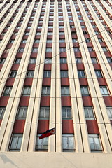 Sixteen story modern building-Jorge Bocobo Str.with Teodoro Kalaw Ave. Ermita-Manila-Philippines-0933 (rweisswald) Tags: tall construction tower skyscraper multistory sixteenstory officebuilding highrise commercial residential creamcolor garnet maroon wall facade cement concrete modern architecture frame structure window row glass glazed closed open outside exterior venetianblind urban street city town vertical filipino philippineflag waving column pillar apartment dwelling lower upperfloor jorgebocobostreet teodorokalawavenue geantonino ermitabarangay manila philippines