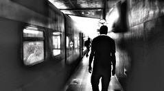 Railway's Rush Hour (Ori Liber) Tags: rushhour gray blackandwhite city urban train trainstation artistic railwaystation railway daylight dark people shadow shadows