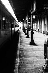 Capo stazione (andreasbrink) Tags: italy winter bw domodossola street train streetphotography blackandwhite trainstation