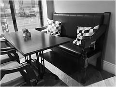 Window Seat (JulieK (thanks for 8 million views)) Tags: nevillesbarandkitchen fethardonsea wexford window bench seat table bw monochrome blackandwhite 2019onephotoeachday iphonese cushions chair windowseat hww