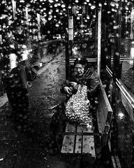 Raindrops (jonwaz) Tags: blackwhite black white bw blackandwhite monochrome jonwaz malmö sweden city train dark blanco y negro people rain raindrops busstop iphone street