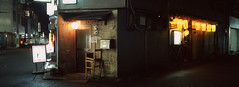 Kyoto Corner (Orion Alexis) Tags: film 35mm analog xpan fujifilm tx1 fujichrome provia 100f travel japan kyoto alley night photography panorama widescreen cinematic wide lantern urban street