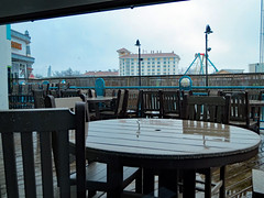Tables On The Deck. (dccradio) Tags: myrtlebeach sc southcarolina horrycounty broadwayatthebeach pavilionamusementpark amusementpark sky greysky graysky cloudy overcast rain rainy raining park ripleysaquarium aquarium ripleys february winter monday mondayafternoon afternoon goodafternoon chair table chairs tables wet hotel motel lodging hamptoninn shoes shoestore deck balcony building architecture husspirate pirate pirat hussrides hussmanufacturing carnival midway fairride amusements amusementdevice mechanicalride ride rides thrillride outdooramusement fun entertainment canon powershot elph 520hs