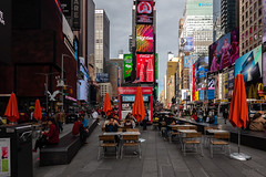 Late Lunch (Jocey K) Tags: sonydscrx100m6 triptocanadaandnewyork architecture buildings street people words signs sky clouds timessq billboards streetperformers tables chairs
