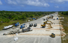 Seabees and U.S. Air Force civil engineers repair a damaged airfield during the COPE North 2019.