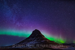 Northern Lights over Kirkjufell in Iceland (Lee Rentz) Tags: churchmountain europe gameofthrones grundarfjörður grundarfjörðurharbour iceland icelandic kirkjufell kirkjufellmountain kirkjufellsfoss mtkirkjufell snæfellsnes snæfellsnesnationalpark snæfellsnespeninsula atlanticocean aurora auroraborealis aweinspiring awesome color colors dark darkness destination dramatic geologic geology high horizontal landmark landscape march milkyway mountain nature night nighttime northernlights nunatak peak scenery sky starry stars tourism travel volcanic wild winter