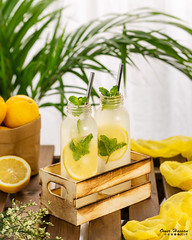 Lemonade 6 (omer.arahman) Tags: lemonade yellow green fresh refreshing summer by window plant leaves palm cloth napkin table straw ice bucket box wood flowers