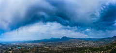 Panorama of storm clouds over mountains (Lukjonis) Tags: ifttt 500px hill mountain range landscape rolling peak scenery snowcapped scenic ridge horizon over land scenics spain panorama clouds storm rain mountains blue rainy canon summer