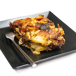 Minced meat moussaka isolated over white background thumbnail