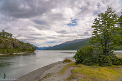 Mountain lake / Горное озеро (Vladimir Zhdanov) Tags: travel argentina tierradelfuego ushuaia lapataia lake landscape nature tree forest water sky cloud mountains mountainside grass