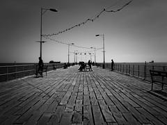 streetlife on the pier (heinzkren) Tags: schwarzweis blackandwhite monochrome panasonic lumix urban street streetphotography cy cyprus pier steg people lines mole landungssteg limassol horizon horizont meer sea silhouette