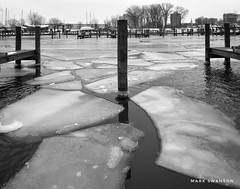 Ice Docks (mswan777) Tags: stjoseph white black monochrome ansel mobile iphone iphoneography apple boat wood michigan nature outdoor frozen cold winter marina slip dock water ice