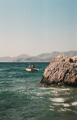 0073-0308-27 (jimbonzo079) Tags: masouri beach kalymnos island κάλυμνοσ dodecanese aegean greece sea boat people seascape water 2018 mountain rock canon ae1 fd 50mm f18 lens fujicolor c200 fuji fujifilm trip travel world europe analog film 35mm 135 color colour art vintage old hellas ελλάσ ελλάδα summer vacation canonae1 fd50mmf18 fujicolorc200 fujic200