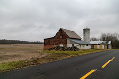 Mitchell Barn — Milford Township, Knox County, Ohio (Pythaglio) Tags: barn building structure historic centerburg ohio unitedstates us outbuilding farm rural road pavement trees field clouds mitchell knoxcounty milfordtownship altered silo metal cladding bank