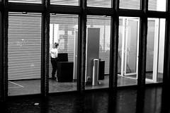 The policewoman (pascalcolin1) Tags: paris13 femme woman police policewoman policière nuit night lumière light reflets reflection pluie rain fenetres windows photoderue streetview urbanarte noiretblanc blackandwhite photopascalcolin 50mm canon50mm canon