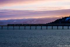 Sandpoint Sunrise (evanlofback) Tags: railroadbnsf spokanesub engineamtk amtrak8 empirebuilder passenger sandpoint sunrise mountains bridge water winter snow