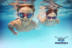 Best swimming pools in India (smartpoolindia) Tags: realpeople candid leisureactivity elementaryage boys twopeople underwaterdiving cute 45years child smiling playing playful divingintowater fun healthylifestyle caucasianethnicity swimminggoggles action accuracy bonding togetherness gettingawayfromitall relaxation joy enjoyment happiness blue turquoisecolored sport vacations lifestyles childhood outdoors lookingatcamera horizontal underwater frontview cheerful swimming recreationalpursuit activity sister brother family people sunlight summer water swimmingpool sunny