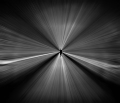 Light travels faster than sound (Fan.D & Dav.C Photgraphy) Tags: circle light abstract art white background black twilight shadow zoom tunnel speed man alone center luminou shining empty