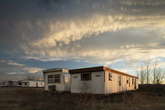 Mobile Home Cloudscape (Notley Hawkins) Tags: httpwwwnotleyhawkinscom notleyhawkinsphotography notley notleyhawkins 10thavenue rural missouri bottomland riverbottoms missouririverbottoms abandoned missouriphotography trees winter 2019 trailer mobilehome callawaycountymissouri callawaycounty cedarcitymissouri cedarcity weeds sky clouds cloudysky sunset warmlight march canontse24mmf35lii